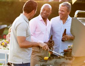Men grilling in backyard